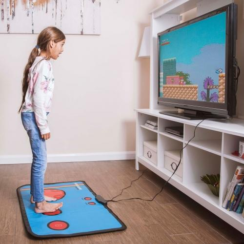 A person playing on a gaming mat